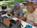 Mike-Lichtman-(KF6KXG)-and-Mark--Kanzler--(KE6ZLP)-prepare-radios-for-Field-Day